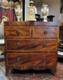 A Regency Flame Mahogany Crossbanded Chest of Drawers